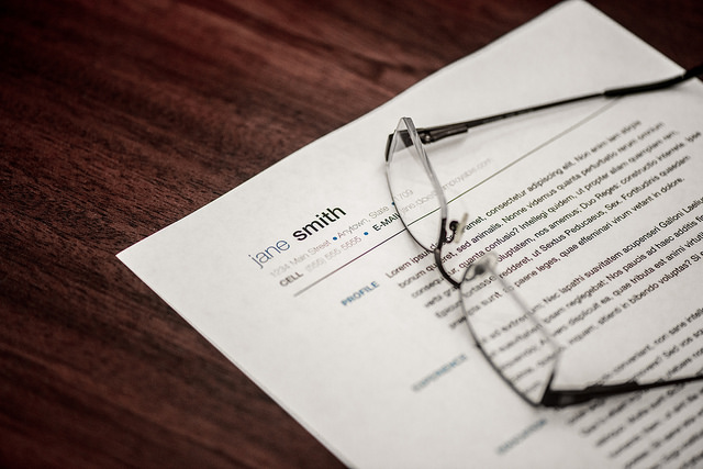 resume on table with eyeglasses