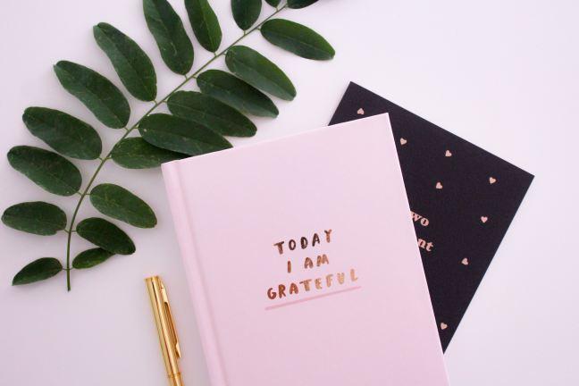 gratitude journal and pen on desk